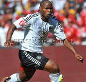 Collins Mbesuma dribbles