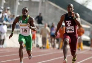(2011) Texas A&M's Gerald Phiri, right, and Baylor's Woodrow Randall compete in the 100-meter dash at the Texas Relays Saturday in Austin, Texas. Phiri won in a meet-record time of 10.06 seconds