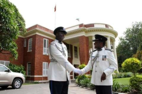 Dr Solomon Jere congratulates Lemmy Kajoba after his appointment and swearing in at State House as Police Commissioner for Muchinga Province