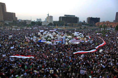 Protesters fill Tahrir as Egypt's President Morsi earlier in July
