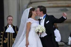 Sweden's Princess Madeleine and Christopher O'Neill kiss outside the Royal Chapel after their wedding ceremony in Stockholm, Saturday June 8, 2013