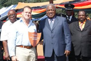 Mr Daniel Munkombwe (Southern Province Minister); Christopher Tett (Managing Director Bushtracks Africa Limited) with the award that was presented by His Excellency Mr RB Banda, The President of The Republic of Zambia; Honourable Austin Liato, Minister of Labour and Social Security (RIGHT)