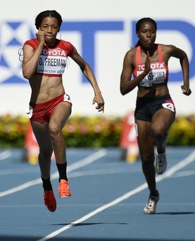 (L-R) US Octavious Freeman and Zambia's Yvonne Nalishuwa run during the women's 100 metres first round at the 2013 IAAF World Championships at the Luzhniki stadium in Moscow on August 11, 2013.