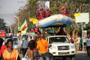 People celebrating in stlyle the hosting of UNWTO General Assembly through street carnival along Livingstone way in Victoria Falls