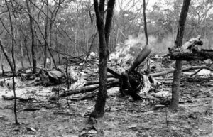 In this Sept. 19, 1961 file photo, searchers walk through the scattered wreckage of the DC6B plane carrying Dag Hammarskjold in a forest near Ndola, Zambia. America's National Security Agency may hold crucial evidence about one of the greatest unsolved mysteries of the Cold War _ the cause of the 1961 plane crash which killed United Nations Secretary-General Dag Hammarskjold, a commission which reviewed the case said Monday, Sept. 9, 2013. Widely considered the U.N.'s most effective chief, Hammarskjold died as he was attempting to bring peace to the newly independent Congo. The crash of his DC-6 aircraft in the forest near Ndola Airport in modern-day Zambia has bred a rash of conspiracy theories, many centering on some startling inconsistencies. (AP Photo)
