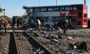 Passenger train, bus collide in Canada's capital, six dead