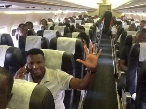 Skipper Chris Katongo gives a wave of confidence as the Chipolopolo settle into their charter aircraft for the flight to Kumasi.
