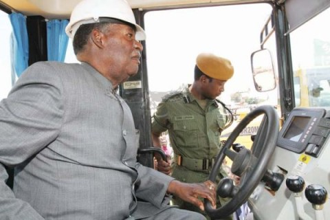 DRIVING THE COUNTRY FORWARD- President Sata goes behind the wheel of an earth-moving equipment during the launch of the 45.5km Chingola-Kitwe dual carriage way in Kitwe yesterday. – Picture by EDDIE MWANALEZA