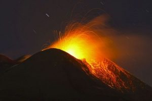 Etna volcano erupts, lighting up sky over Sicily. Etna erupts occasionally. Its last major eruption occurred in 1992.