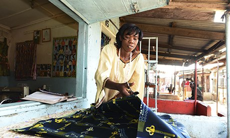Isabel Kachinda at her tailoring shop in Bwafwano market, which she has built up thanks to business