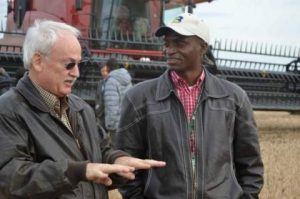 Kelvin Kamfwa, right, talks with Iowa farmer Ron Heck during a World Food Prize tour.