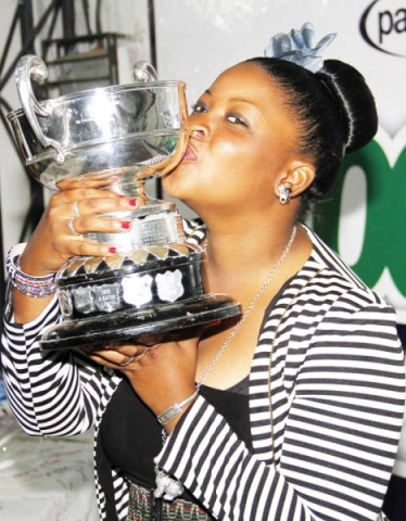 MELISSA Nawa kissing the trophy on Sunday after winning the Zambia Ladies Open Golf Championship, which was held at Lusaka Golf Club. - Picture by MACKSON WASAMUNU