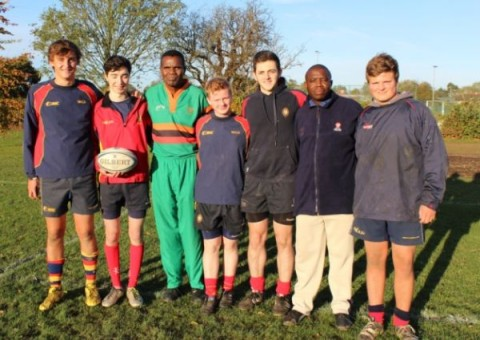 Zambian visitors Joseph Ingwe (left) and Caution Bweupe (right) with members of the Wisbech Grammar School 1st XV