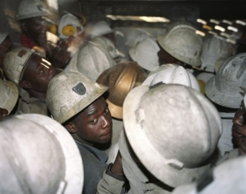 30 employees of Mopani Copper Mines (MCM) are crowded in the elevator, which will bring 1.5 km below the earth to work in the film SOB copper mine. The Swiss commodities company Glencore's Mopani Copper Mines majority shareholder of and employs approximately 20,000 Zambians.