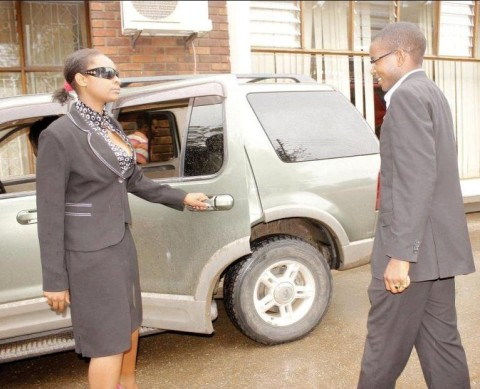 A 'Ghadafi style' female bodyguard opens the door for NRP president Dr.Cosmo Mumba