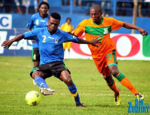 Abubaker of Tanzania Mainland shield the ball from Stanley Shimbi of Zambia