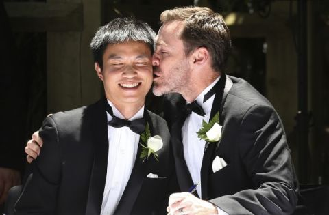 Ivan Hinton, right, gives his partner Chris Teoh a kiss after taking their wedding vows during a ceremony at Old Parliament House in Canberra, Australia, Saturday, Dec. 7, 2013. Dozens of same-sex couples from all around the country took advantage of the Australia Capital Territory's new law allowing same-sex marriages. But the unions will be short lived: The High Court overturned the law on Thursday, Dec. 12, 2013.
