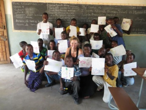 Emily McKeone, a Peace Corps volunteer and University of Nebraska-Lincoln graduate, poses with students of a rural school in the Luapala province of Zambia. McKeone is raising money to build three wells for three local schools in Zambia