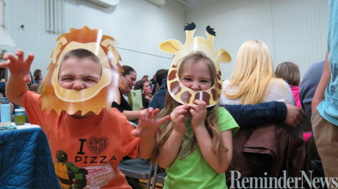 Alexander, 6, and Gabriella, 5, become African animals for the evening at Voluntown Elementary School's Chikambuso Night. Photos by Janice Steinhagen.