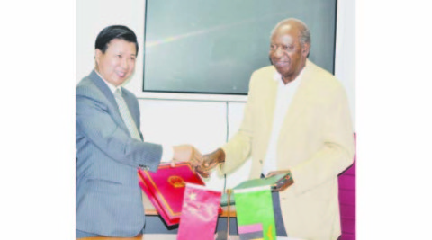 FINANCE and National Planning Minister Alexander Chikwanda and Chinese Ambassador to Zambia Yuxiao Zhou exchange documents after signing the agreements on a grant and interest free loan given to the Zambian Government by China yesterday in Lusaka. Picture by CLEVER ZULU