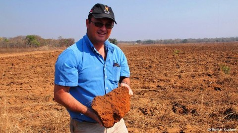 George Allision holds a hard clump of earth in his hands weighing about five kilograms