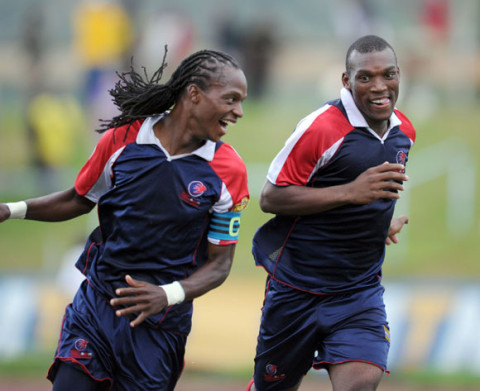 Mfanafuthi Mbhembe of Mbabane Swallows celebrates with teammate Sabelo