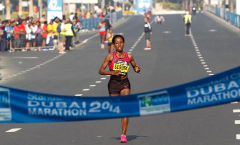Mula Seboka Seyfu of Ethiopia, touching the finishing line during the Standard Chartered Dubai Marathon at Umm Suqeim Road in Dubai on January 24. KT photo by Juidin Bernarrd