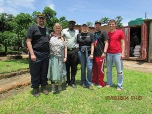 Toby and Cherie Curtis, Pastor Chanda, Carrie and Isaac Curtis and Ryan Krzeszewski standing together in Zambia. Submitted by Carrie Curtis