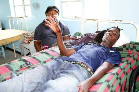 43-YEAR-OLD Mazabuka accident survivor Joseph Nsamba explaining his ordeal at Mazabuka District Hospital on Friday, looking on is his wife Phoebe. - Picture by ANGELA MWENDA.