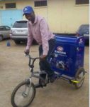 A bicycle vendor sells Engen products directly to taxi and bus drivers in Lusaka, Zambia.