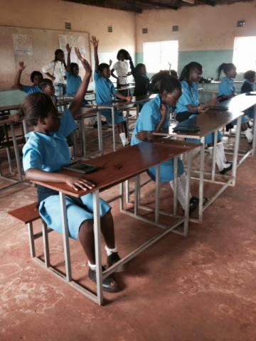 Mpika Grade 5 girls learning to use the tablets