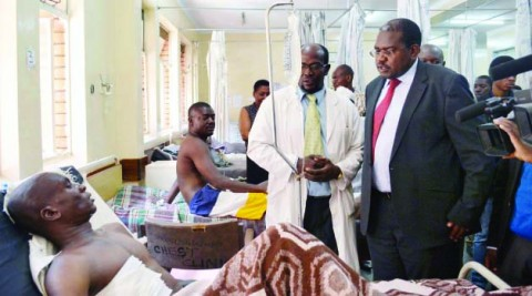HEALTH Deputy Minister Chitalu Chilufya visits one of the Feb 21st Mazabuka accident victims evacuated to the University Teaching Hospital in Lusaka yesterday. Picture by KAIKO NAMUSA
