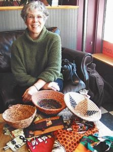 JOANNE BOLLINGER displays goods made at the Women's Center sponsored by WISE in Kaoma, Zambia. ROSANNA GARGIULO : THE TIMES RECORD