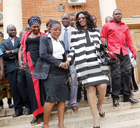 MINISTER of Tourism and Arts Sylvia Masebo (middle) after appearing before the tribunal at Supreme Court in Lusaka yesterday. – Picture by COLLINS PHIRI.