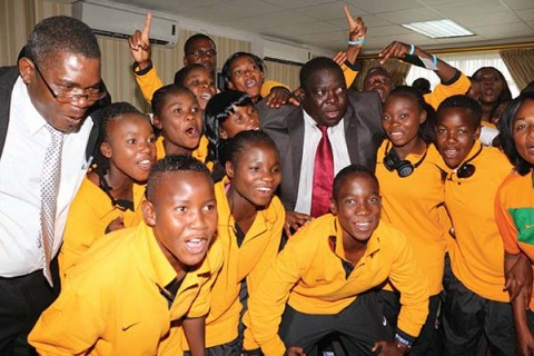 MINISTER of Youth and Sport Chishimba Kambwili (middle) and his deputy Christopher Mulenga (left) with under-17 women's national team players at Lusaka's Kenneth Kaunda International Airport yesterday. – Picture by JEAN MANDELA.