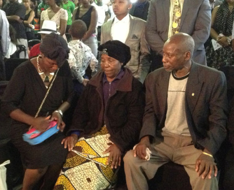 On the front row: Late Dennis Lota's father and mother, and his sister Rose during the burial Church service