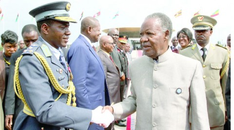PRESIDENT Michael Sata greets Zambia's military attaché in the Democratic Republic of the Congo Brigadier General Fredy Milamba before departure for Zambia yesterday. Picture by EDDIE MWANALEZA