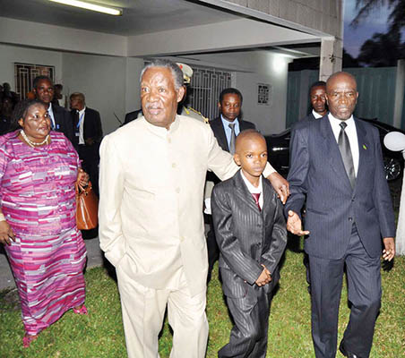 PRESIDENT Sata with Mambwe Wilombe, wife of Zambia's ambassador to DR Congo Fidelis Kapoka, Regina (left) and Zambia's Ambassador to Congo Kapoka (right) on arrival at the Zambian Embassy where the President mate Zambians leaving in Congo DR on Feb 25,2014. -Picture by THOMAS NSAMA.