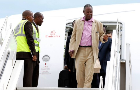 President Michael Sata alights from Emirates plane at Kenneth Kaunda International Airport from London -Pictures by EDDIE MWANALEZA