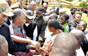 President Michael Sata upon arrival in Katuba Constituency for a rally to drum up support for PF parliamentary candidate Moses Chilando (in white T-shirt) on Feb 15,2014 -Picture by THOMAS NSAMA
