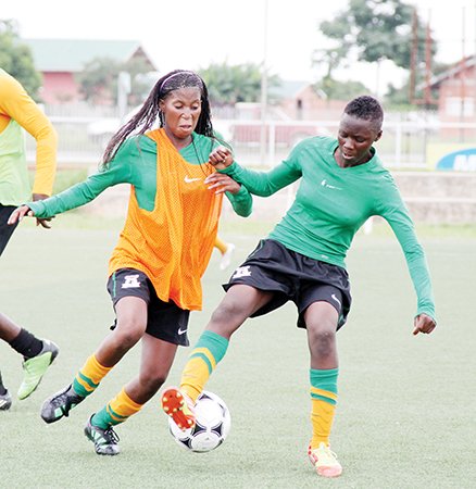 ZAMBIA under-17 national team players Martha Tembo (left) and Memory Phiri duel during training at Olympic Youth Development Centre in Lusaka yesterday. – Picture by ANGELA MWENDA.