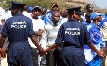 Zambia police cordon off ruling MMD party supporters outside the Supreme Court in the capital Lusaka when Rupiah Banda filed his re-election nomination papers on August 10, 2011. ELIAS MBAO|AFRICA REVIEW