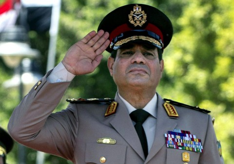 n this Wednesday, April 24, 2013 file photo, Egyptian Defense Minister Gen. Abdel-Fattah el-Sissi salutes during an arrival ceremony for U.S