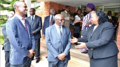 ACTING Chief Justice Lombe Chibesakunda shares a light moment with Legal and Judicial Reforms Commission chairperson Frederick Chomba (centre) and Finance Deputy Minister Keith Mukata after the swearing-in ceremony of the commissioners in Lusaka yesterday. Picture by CLEVER ZULU