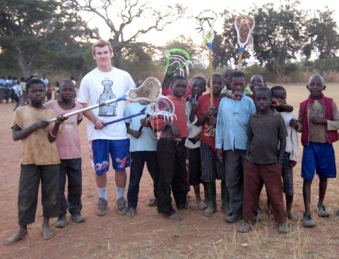 Connor Donahue of Groton, on a Bishop Guertin mission to Zambia, where he taught lacrosse to a group of young kids. (COURTESY PHOTO)