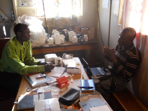 Data Collection Officer Mambwe Ng'oma interviews an Environmental Health Technologist (EHT) at Bushinga Rural Health Center, Itezhi-Tezhi, Zambia