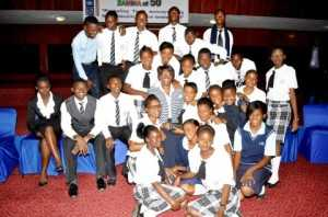 First Lady Dr Christine Kaseba pose for a photograph with Lusaka High School pupils during the First Lady's Mentorship programme at Mulungushi International Conference Centre on March 11,2014
