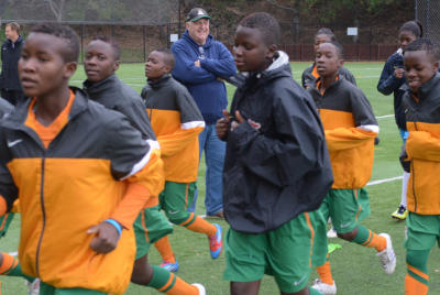 Geoffrey Levy watches the Zambia womens u-17 national soccer team warm up at practice on Monday, Mar. 3, 2014, in San Rafael, Calif. He is helping the girls, age 14-17, achieve a spot in the World Cup games. (Frankie Frost/Marin Independent Journal) Frankie Frost