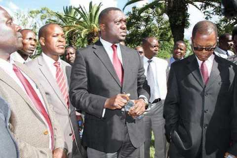 MAZABUKA Member of Parliament Garry Nkombo (centre) with colleagues from UPND and other opposition members of parliament who have been boycotting Parliamentary proceedings from last week ponder on their next course of action. The MP's were found standing outside Parliament buildings yesterday afternoon. – Picture by ANGELA MWENDA.