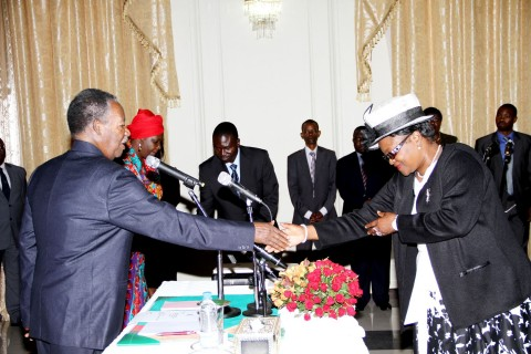 President Sata congratulates newly appointed deputy Minister of Community Development, Mother and Child Health Ingrid Mpande during the Swearing-in-Ceremony at State House in Lusaka on March 27,2014 -Picture by THOMAS NSAMA